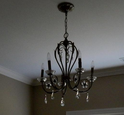 five-light-candle-style-dark-metal-glass-indoor-chandelier